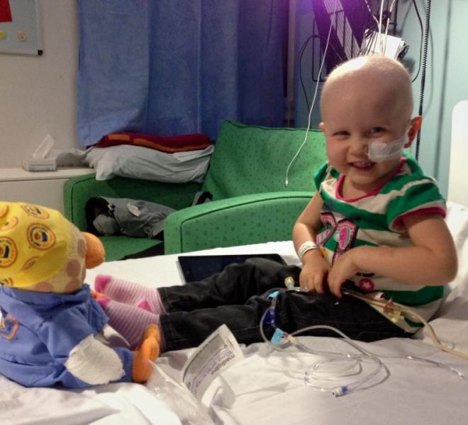 Isabelle smiling with Chemo Duck